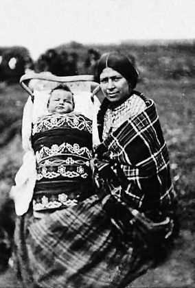 An old photograph of a Chippewa Woman and Child in Cradle-Board.