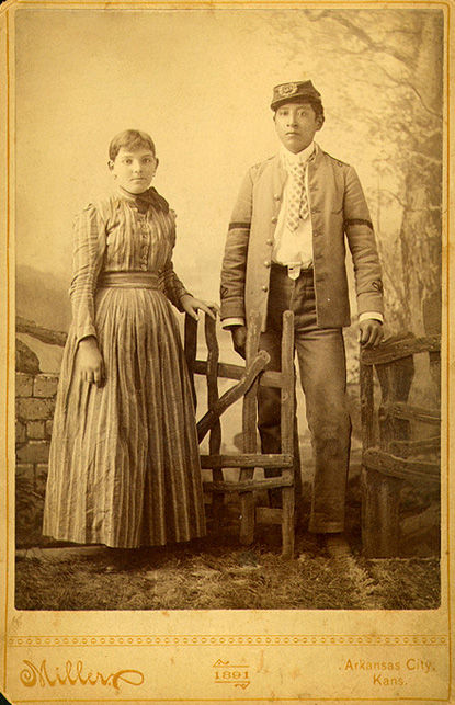 An old photograph of Dan Horse, Pawnee Chief and Anna Smith, Ottawa in European Clothes.