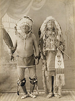 An old photograph of Follows The Woman and Bull Man - Brule Lakota.