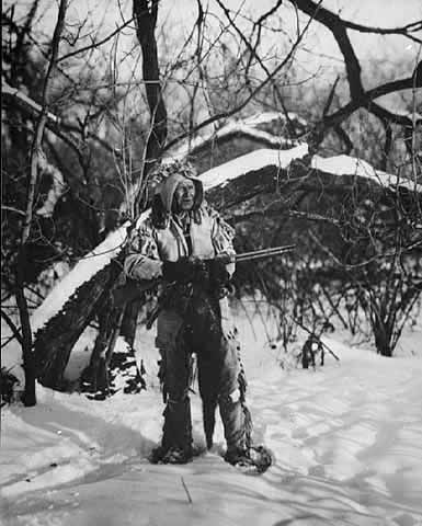 An old photograph of an Indian Hunter in Winter.