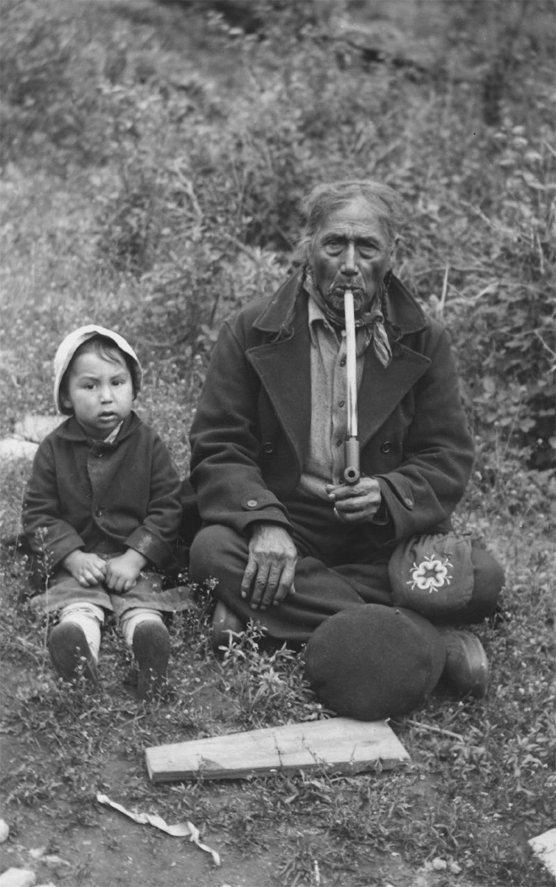 An old photograph of John Bear Smoking a Ceremonial Pipe - Sisseton.