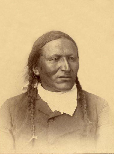 An old photograph of John Grass - Blackfoot [A].