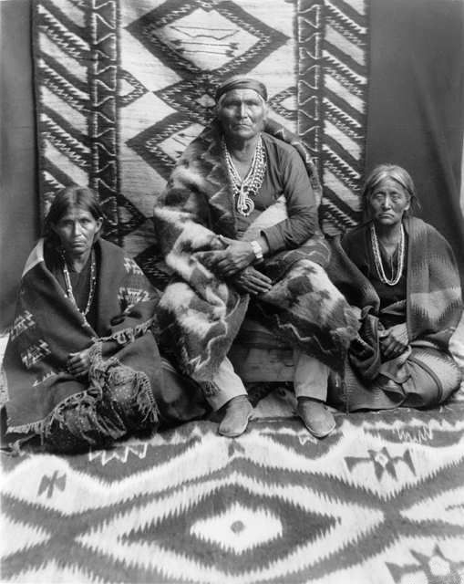An old photograph of Judge Clah and His Wives - Navajo.
