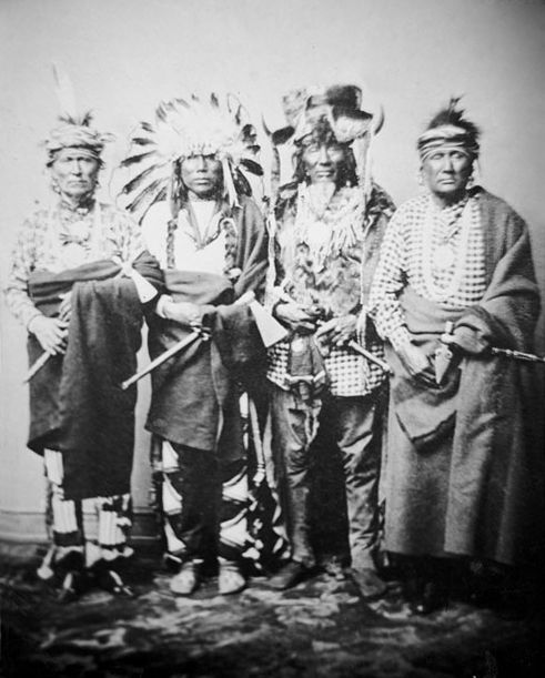 An old photograph of Lone Chief with Standing Buffalo Bull, Iron Whip, and Walks With Effort I - Ponca 1858.