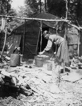 An old photograph of Maggie Sam Boiling Maple Sap - Mille Lacs.