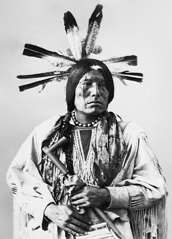 An old photograph of Man Packs The Eagle - Cuthead Sioux 1872.