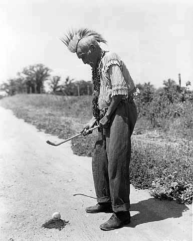 An old photograph of a Man Playing Shinny at White Earth Reservation.