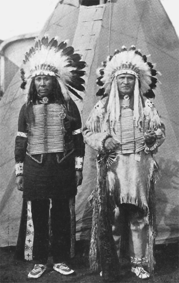 An old photograph of Mark Spider and Sam Lone Bear Stand Before a Tipi.