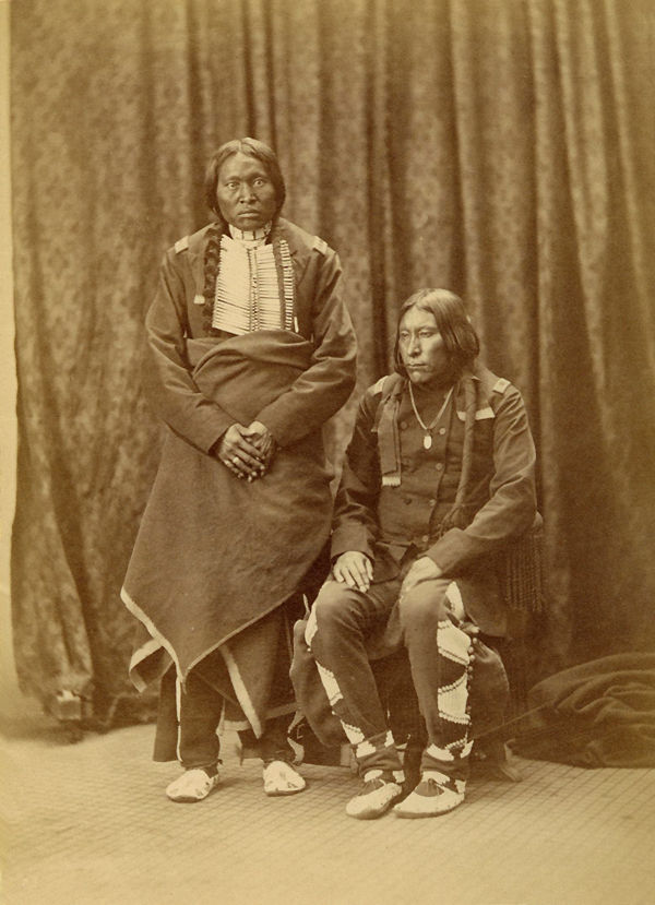 An old photograph of Medicine Pipe and Fool Dog - Arapaho 1871-73.