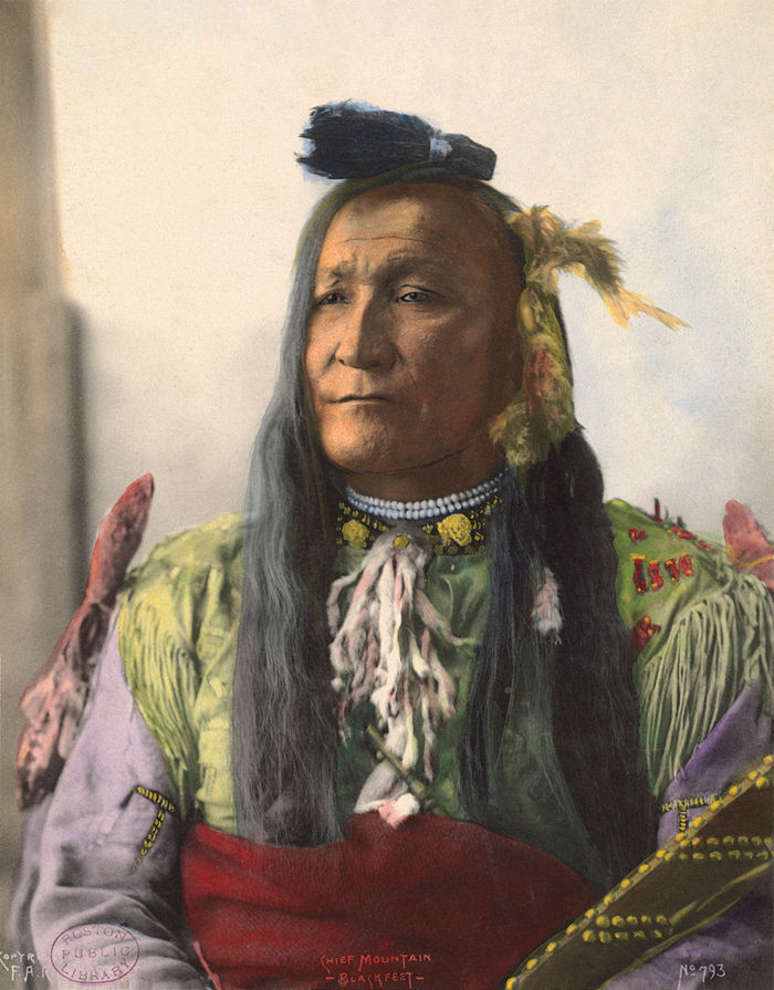 An old photograph of Mountain Chief aka Ninastoko - Blackfeet 1898 [Colorized].