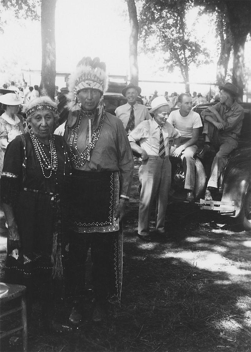 An old photograph of a Native American Couple in Ceremonial Dress.