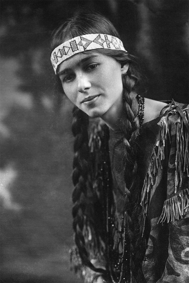 An old photograph of a Native American Girl in Traditional Dress [A].