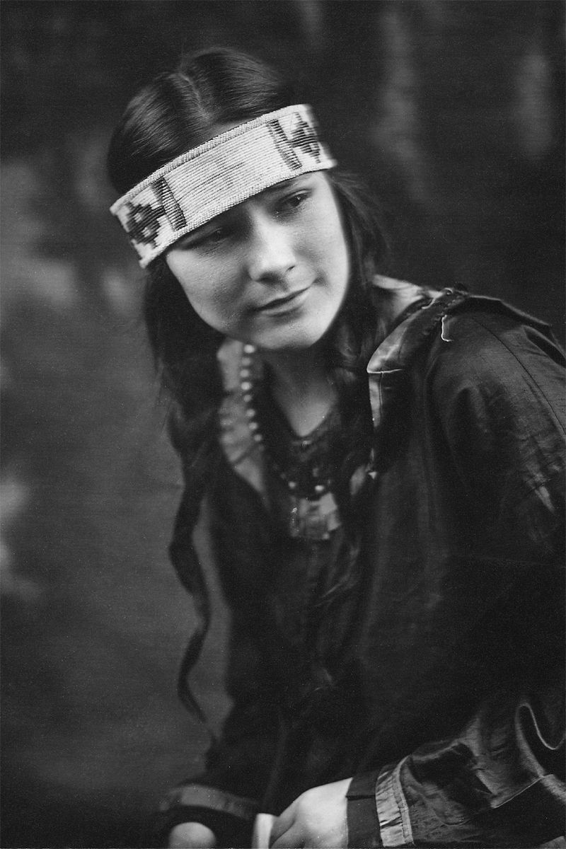 An old photograph of a Native American Girl in Traditional Dress [B].