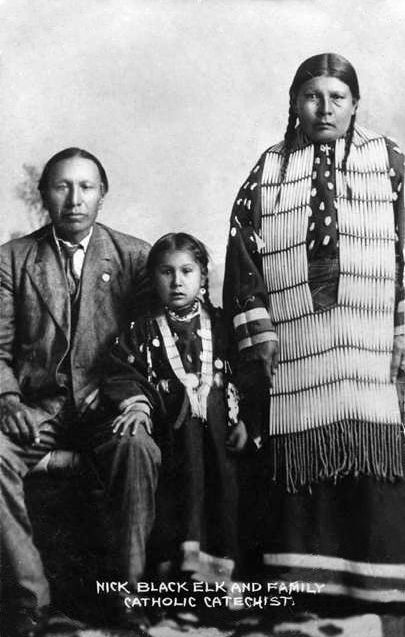 An old photograph of Nicholas Black Elk with Wife and Daughter, Lucy Looks Twice - Oglala c1900.