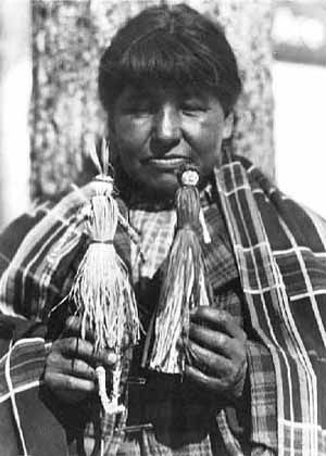 An old photograph of Oge-ma-wi-gah-bow-equay with Basswood Dolls.