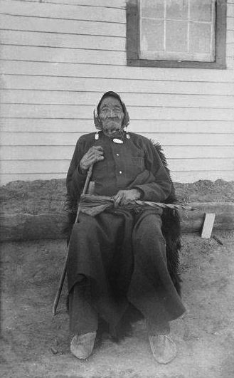 An old photograph of Old Harney Sitting in a Chair.