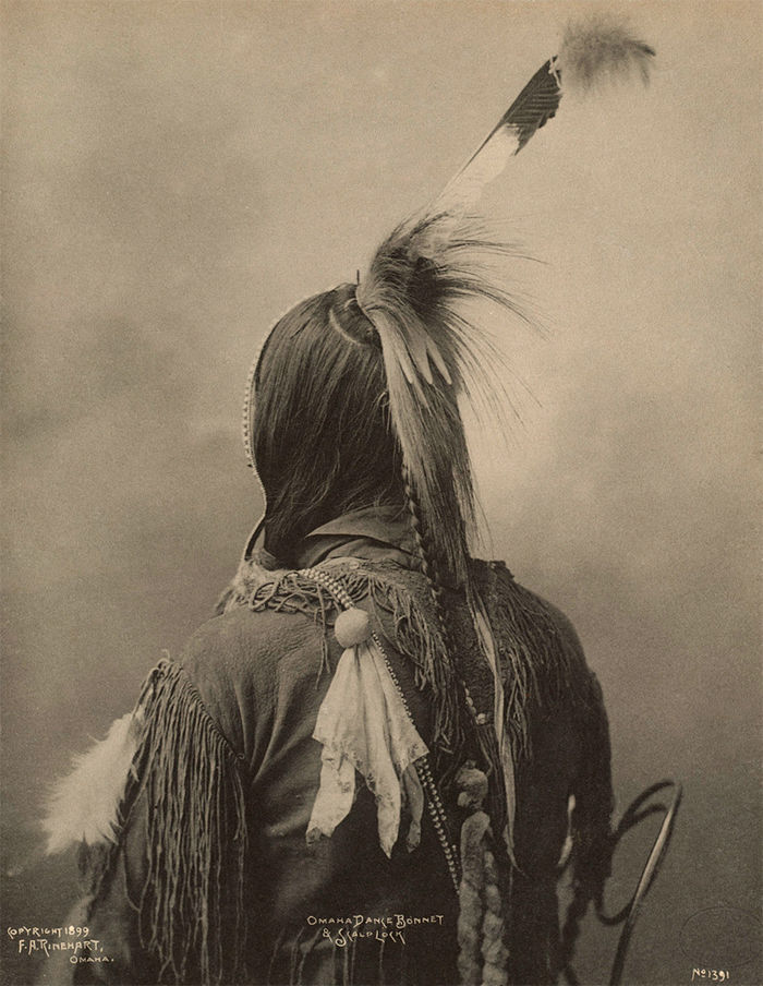 An old photograph of an Omaha Dance Bonnet and Scalp Lock 1899.