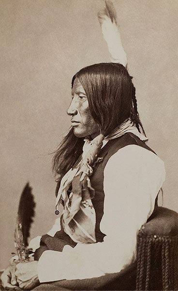 An old photograph of Paints His Face White - Sicangu 1872.