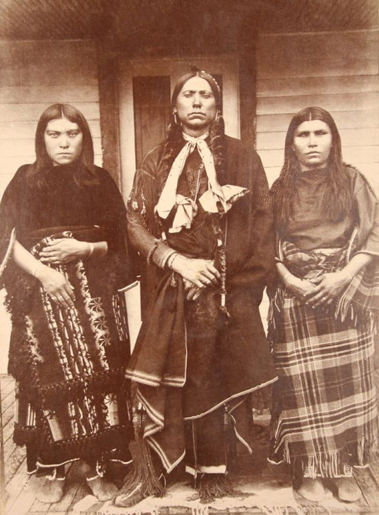 An old photograph of Quanah Parker and Two of His Wives, Topay (or Tonarcy) with Chonie - Comanche c1890.