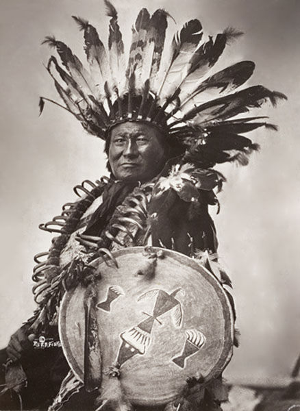 An old photograph of Rain In The Face Wearing a Bear Claw Necklace - Lakota Chief.