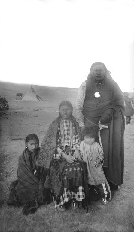 An old photograph of Spotted Elk with Wife and Children - Oglala 1892.