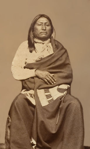 An old photograph of Spotted Tail aka Sinte Gleska aka Jumping Buffalo aka Tatanka Napsica - Brule Sioux Warrior 1870.