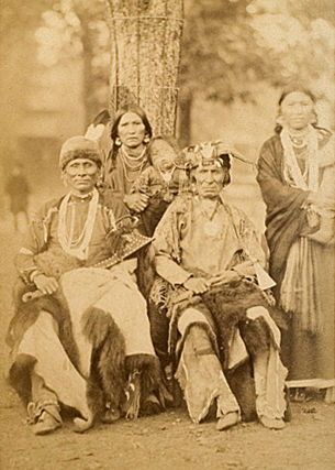 An old photograph of Standing Bear with Yellow Smoke and Wives - Omaha 1883.
