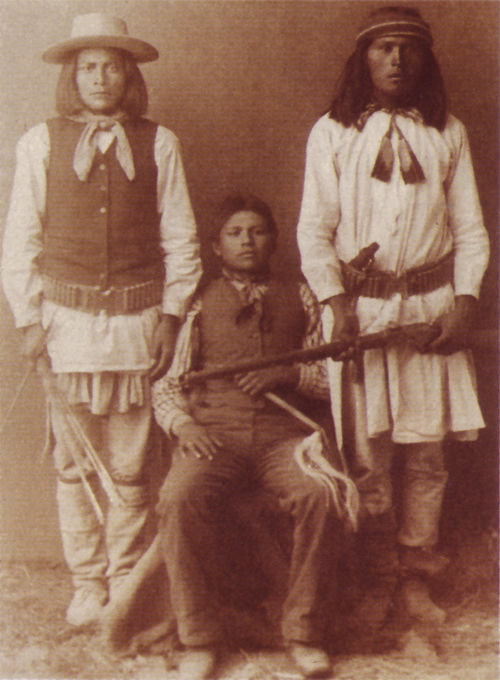 An old photograph of Two Apache Scouts and an Indian School Boy - Wilcox, Arizona 1884.