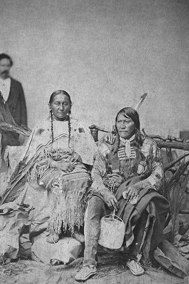 An old photograph of Two Strike and Wife - Sicangu 1872.