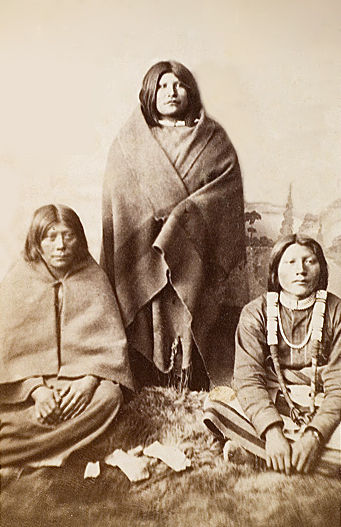 An old photograph of a Ute Mother with Son and Daughter c1868.