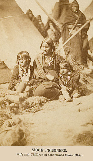 An old photograph of the Wife and Children of Condemned Sioux Chief 1864.