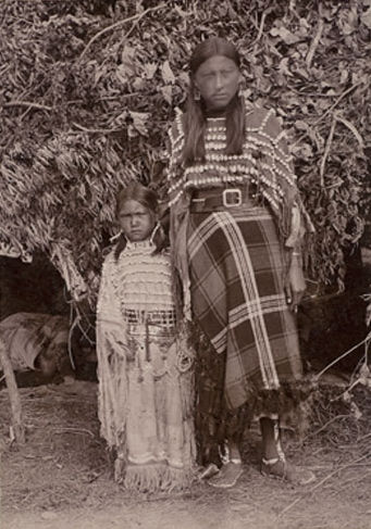 An old photograph of the Wife and Daughter of Apiatan aka Wooden Lance.