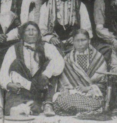 An old photograph of Young Bad Wound and Wife; Rosie Red Top - Oglala 1875.