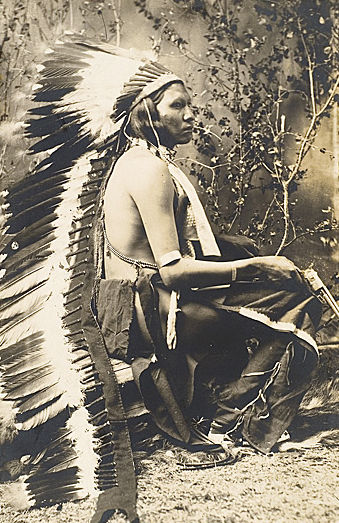 An old photograph of Young Calf - Arapaho.
