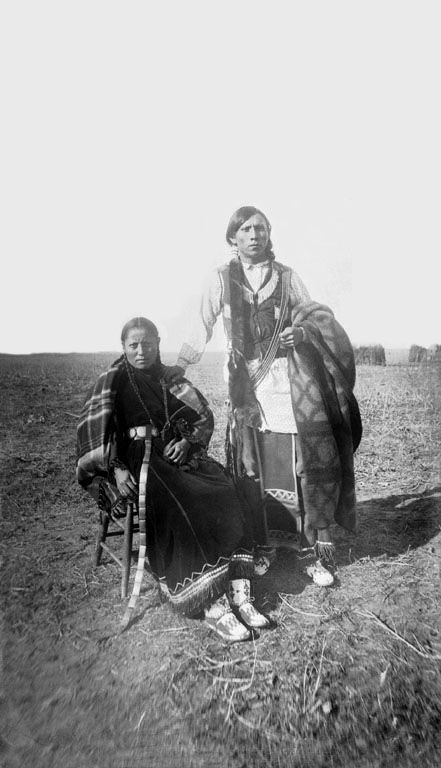 An old photograph of a Young Southern Cheyenne Man and Wife 1893.