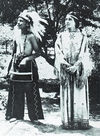 A Cherokee Boy and Girl Traditionally Dressed.