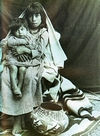 A Laguna Pueblo Indian Woman with Child.