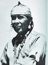 A Navajo Man Wearing a Turquoise Necklace.
