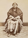 A Winnebago Woman Sitting.