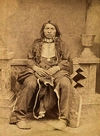 A Yankton Indian Sitting Down wearing a Breastplate.