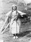A Yurok Indian Wearing a Shell Skirt.