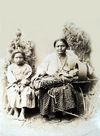 An Apache Woman with her Child and Cradle.