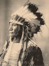 Broken Arm wearing a Head-dress, an Oglala Sioux.