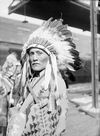 Kee Kensol, a Navajo Indian wearing a Headdress.