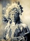 Last Horse, an Oglala Sioux, wearing a Headdress.