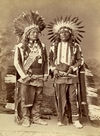 Two Ute Warriors wearing Headdresses.