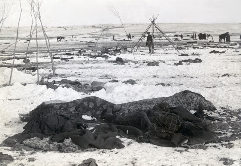 An old photograph of The Aftermath of Wounded Knee [B].