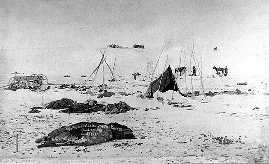 An old photograph of the Wounded Knee Massacre [A]