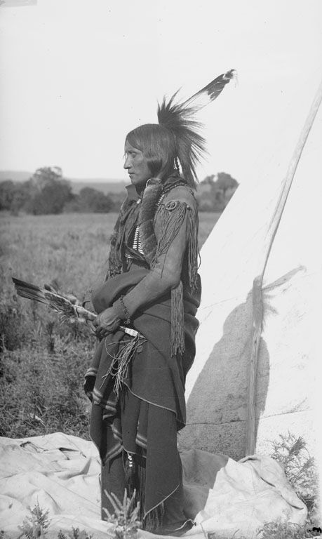 A photograph of a Comanche Indian Man 1891.