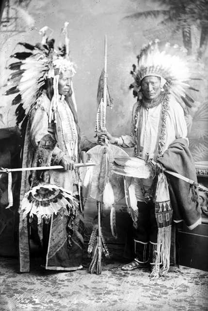 American Indians : Two Unidentified Crow Indians Wearing War Bonnets.